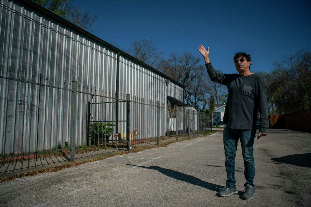 Armando Lichtenberger, Jr. stands near where a survey spike marks the spot where property will be seized for the impending Interstate 45 in the Near Northside neighborhood of Houston on Jan. 7, 2020.