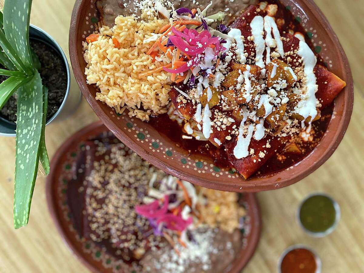 Tlahco Mexican Kitchen serves cheese enchiladas in both a rojas style with Oaxaca cheese and potatoes, top, and an enmoladas style with queso fresco and Mexican mole, bottom.