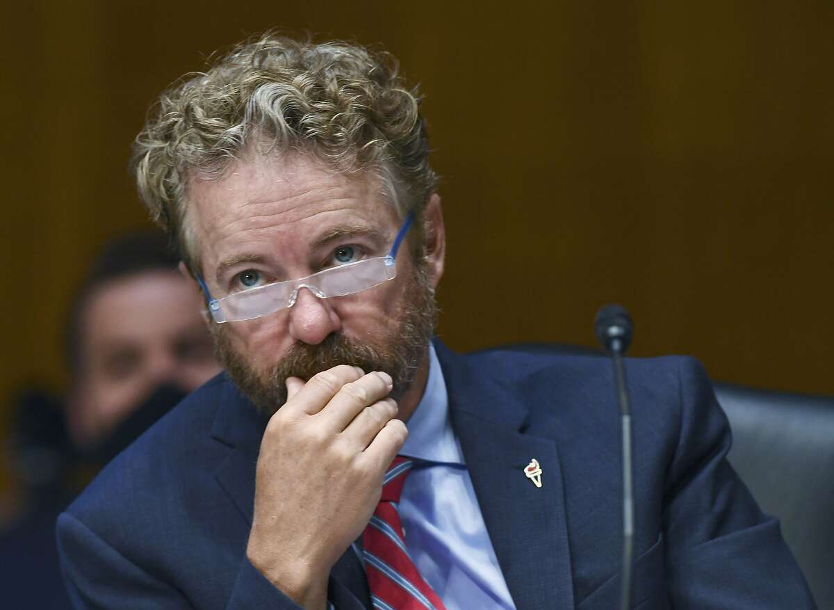 Sen. Rand Paul, R-Ky., listens to testimony before the Senate Committee for Health, Education, Labor, and Pensions hearing, Tuesday, May 12, 2020 on Capitol Hill in Washington. Dr. Anthony Fauci, director of the National Institute of Allergy and Infectious Diseases, is to testify before the committee. (Toni L. Sandys/The Washington Post via AP, Pool)