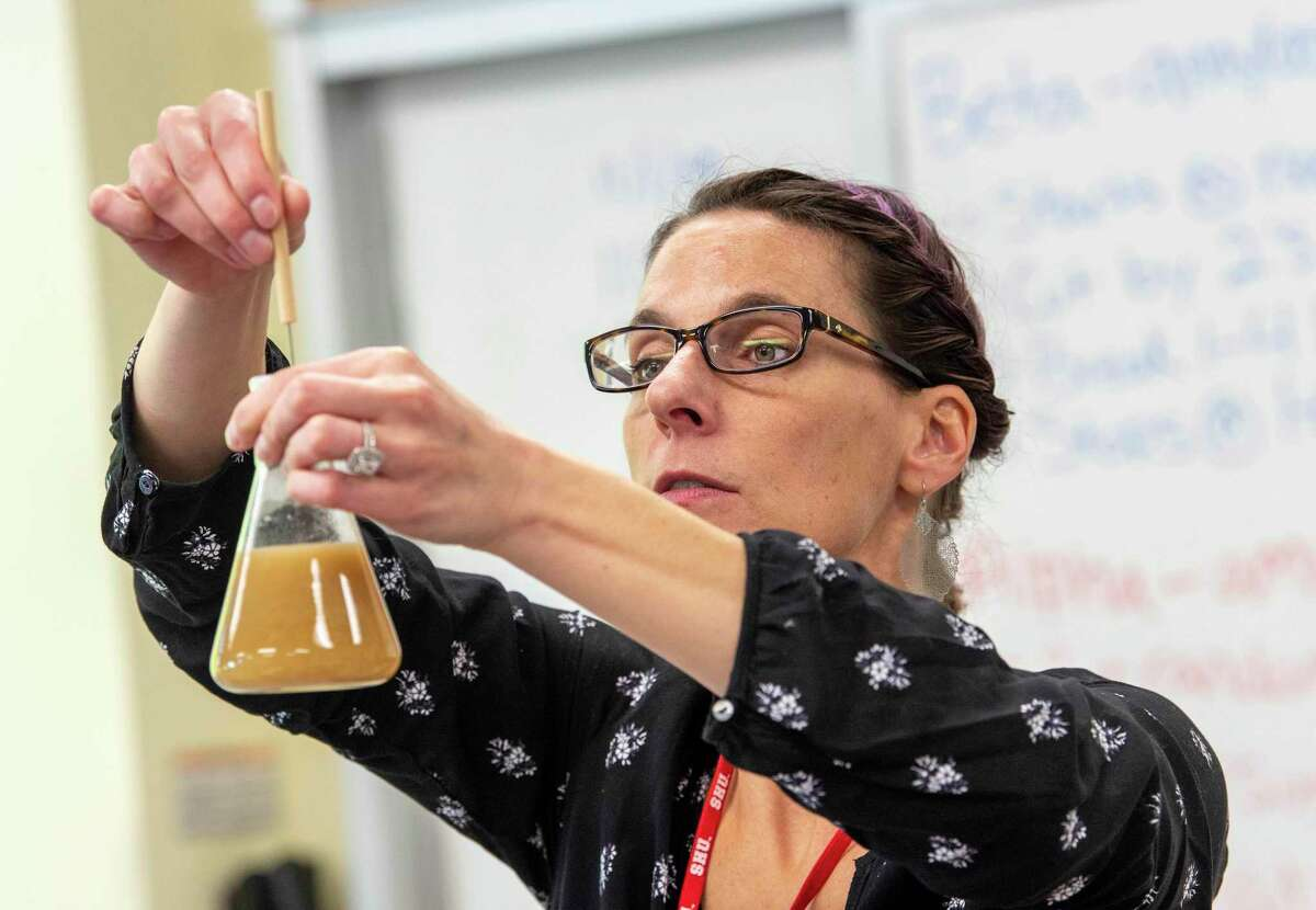 """Nicole Roy, biology professor at Sacred Heart University teaches different brewing steps in her""""Concepts in Biology"""" class in November."""