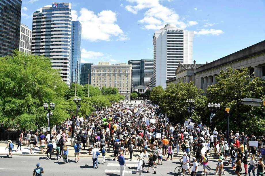 People gather at Legislative Plaza during a rally to protest the death of George Floyd May 30 in Nashville, Tenn. Photo: Larry McCormack, MBR / Associated Press / THE TENNESSEAN