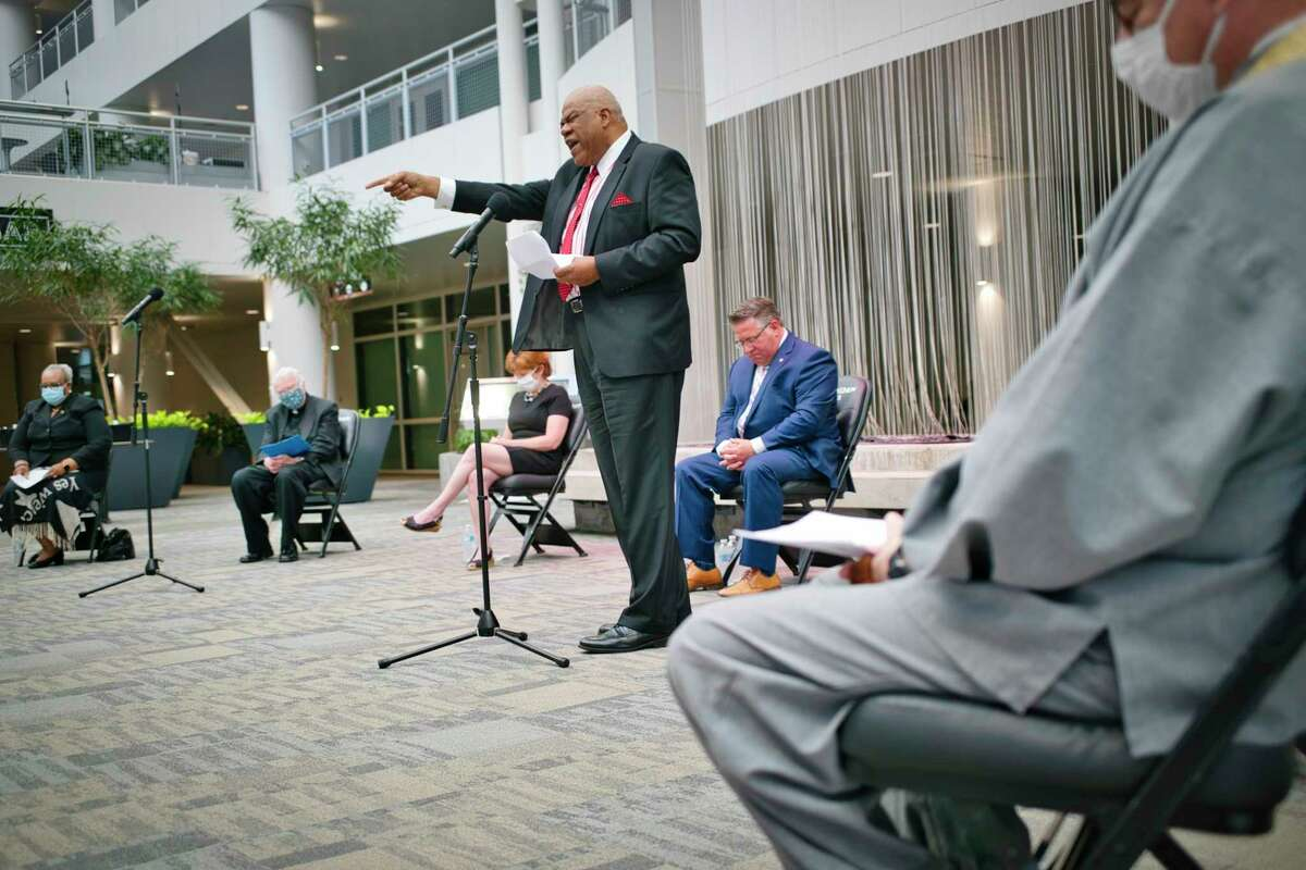 """David Traynham of Sweet Pilgrim Baptist Church in Albany leads a prayer at a vigil in the atrium of the Times Union Center last June. On Monday, Jan. 25, the church will be the site of a state deployment of community coronavirus vaccination kits, part of an effort that Gov. Andrew M. Cuomo's office said will """"strengthen fairness and equity in the vaccine distribution process."""" (Paul Buckowski/Times Union)"""