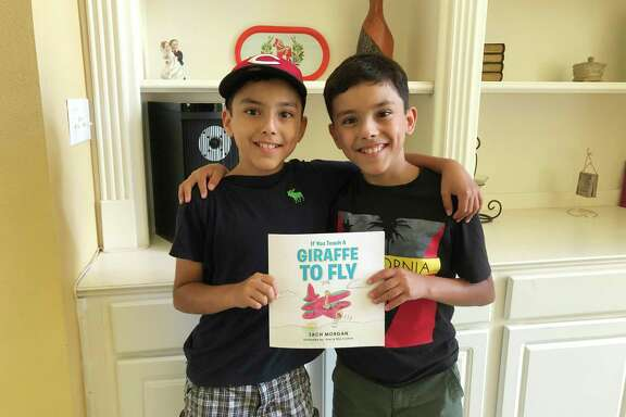 """Huffman twin brothers Eliel and Elio Cortina illustrated a children's adventure book,""""If You Teach a Giraffe to Fly"""" written by a family friend,Zach Morgan, a nurse at Texas Children's Hospital."""