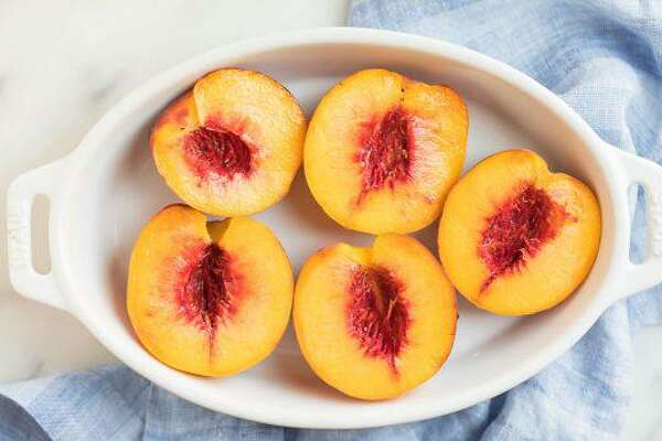 Baked Peaches recipe, by Erin Clarke, author of The Well Plated Cookbook and creator of the healthy recipe blog Well Plated by Erin www.wellplated.com