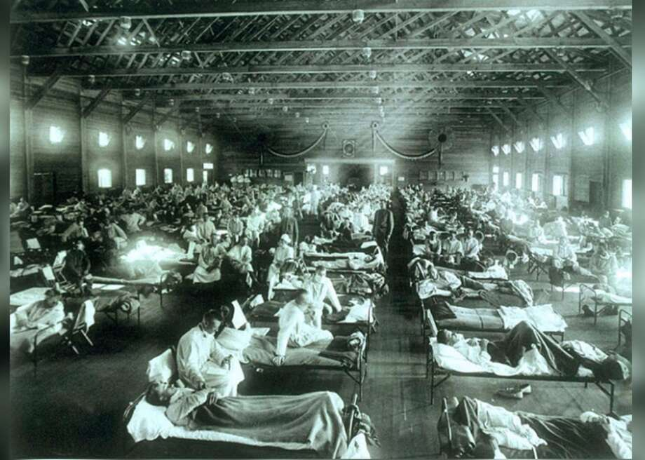 1918: Spanish flu During the influenza epidemic of 1918, quarantine centers and emergency military hospitals like this one in Camp Funston, Kansas, were constructed at various outposts throughout the U.S. A third of the world's population was infected, and at least 50 million died (675,000 in the U.S. alone)—making the Spanish flu among the deadliest outbreaks in human history. This iconic photograph is from a collection belonging to the National Museum of Health and Medicine, Armed Forces Institute of Pathology, Washington D.C. This slideshow was first published on Stacker Photo: National Museum Of Health And Medicine // Wikimedia Commons
