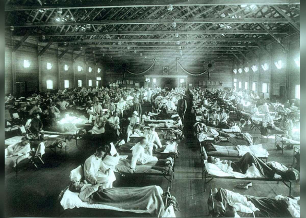 1918: Spanish flu During the influenza epidemic of 1918, quarantine centers and emergency military hospitals like this one in Camp Funston, Kansas, were constructed at various outposts throughout the U.S. A third of the world's population was infected, and at least 50 million died (675,000 in the U.S. alone)-making the Spanish flu among the deadliest outbreaks in human history. This iconic photograph is from a collection belonging to the National Museum of Health and Medicine, Armed Forces Institute of Pathology, Washington D.C. This slideshow was first published on Stacker