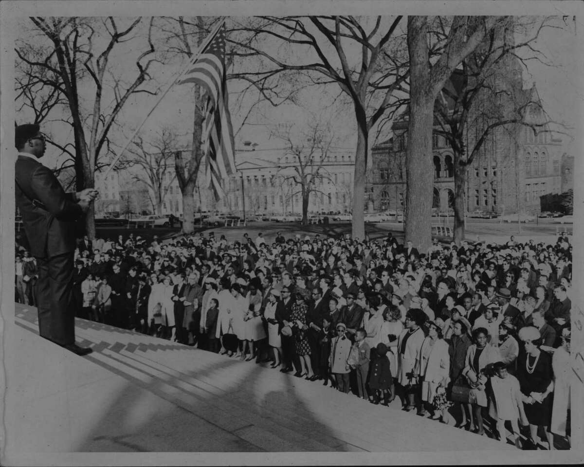 """Albany, New York - A crowd of approximately 2010 ... the lower steps of the Capital singing """"We Shall Overcome"""" at the conclusion of a citywide memorial service for the slain Negro leader Dr. Martin Luther King, Jr. April 08, 1968 (Times Union Archive)"""