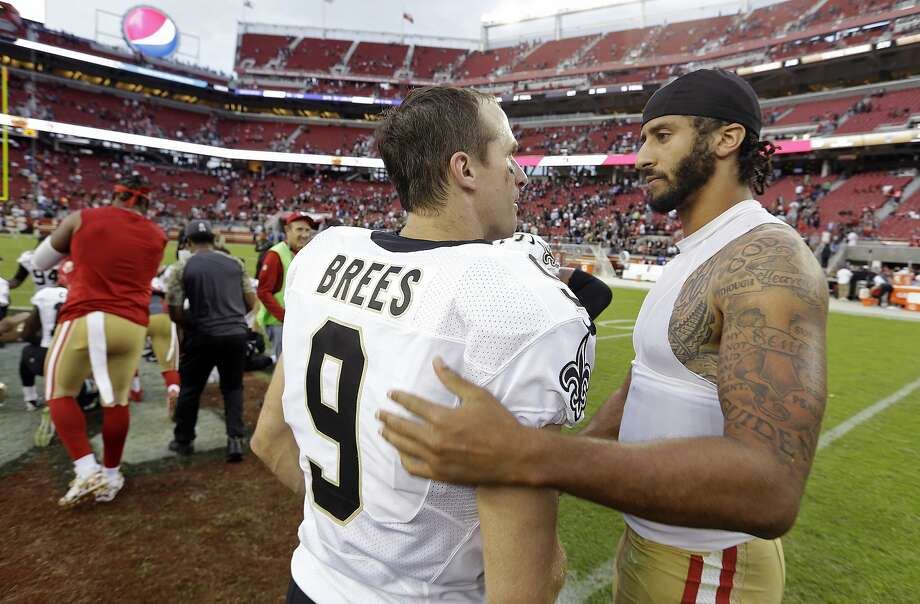 Then-49ers' quarterback Colin Kaepernick, right, and New Orleans Saints quarterback Drew Brees shake hands after a Nov. 6, 2016, game at Levi's Stadium. Brees on Thursday apologized a day after making comments regarding Kaepernick's kneeling during the national anthem. Photo: D. Ross Cameron / Associated Press 2016