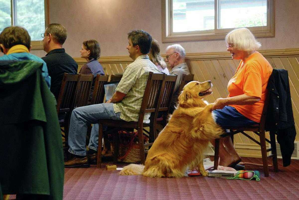 Nora Salaway, of Saratoga Springs, and her dog, Nala share a special moment Sunday during a Blessings of the Animals service at Unitarian Universalist Congregation of Saratoga Springs. The yearly service also honors pets that have died. (Paul Buckowski / Times Union)