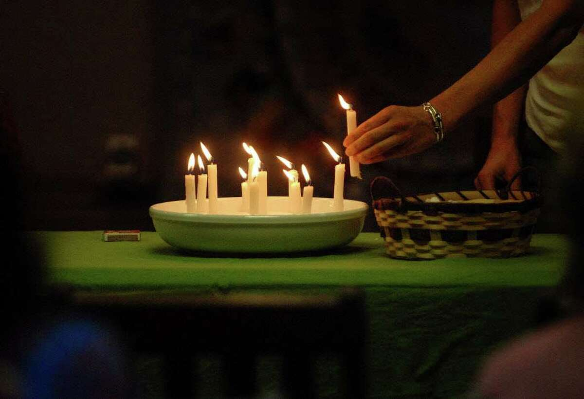 Candles are lit Sunday in remembrance of pets who have died during a Blessings of the Animals service at Unitarian Universalist Congregation of Saratoga Springs in Saratoga Springs.. (Paul Buckowski / Times Union)