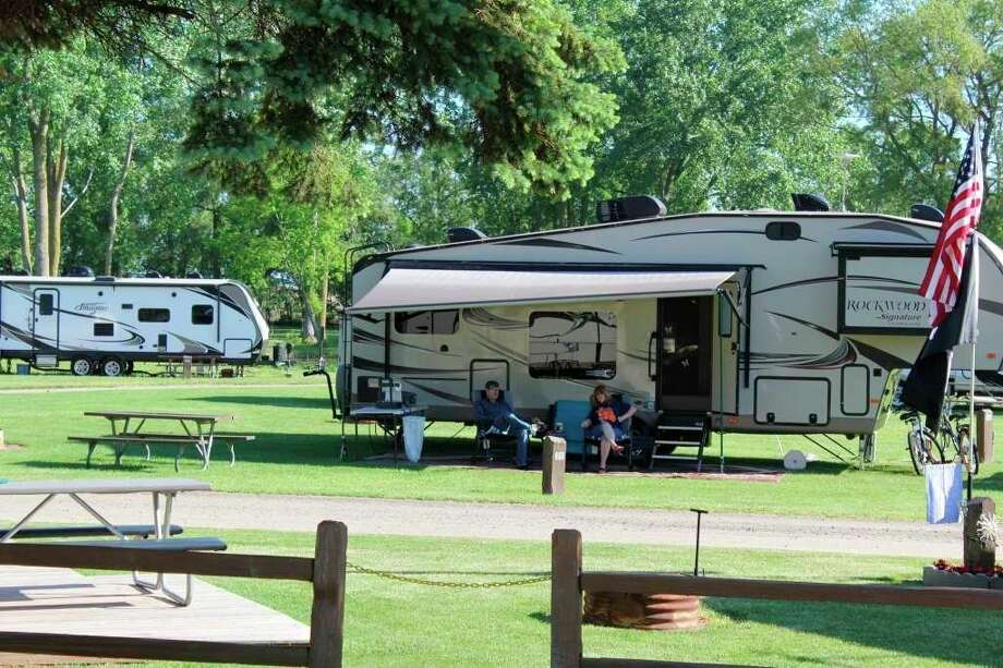Some campers enjoy Sebewaing County Park during June of 2019. The Huron County Road Commission hopes to have the county's parks fully open later this month. (Tribune File Photo)