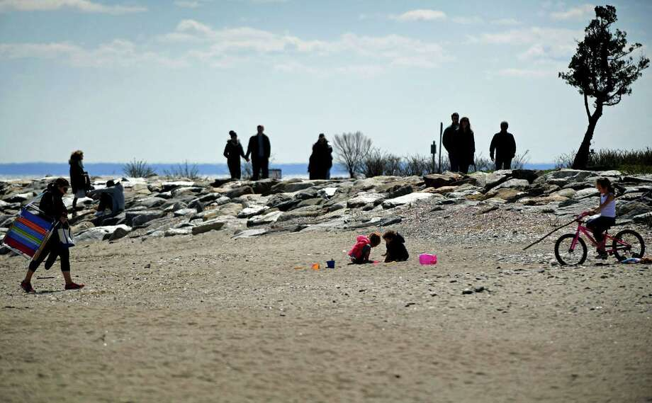 Visitors take adavantage of the nice weather Wednesday, April 1, 2020, at Sherwood Island State Park in Westport, Conn. Photo: Erik Trautmann / Hearst Connecticut Media / Norwalk Hour