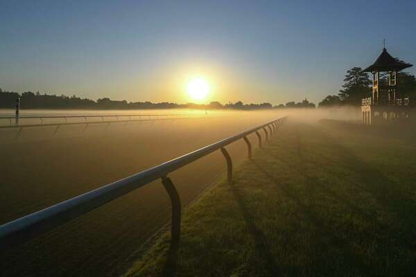 A fog blankets the track before the horses go out to gallop at the Oklahoma Training Center track as it opens for the first time this season Thursday June 4, 2020 in Saratoga Springs, N.Y. Photo Special to the Times Union by Skip Dickstein