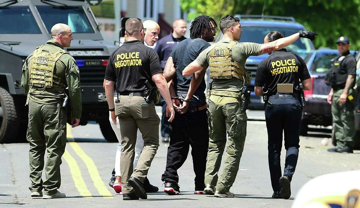 A 45-year-old man was taken into custody at 11:45 a.m. after allegedly a holding a woman hostage in an apartment on Henry Street in New Haven June 4, 2020.