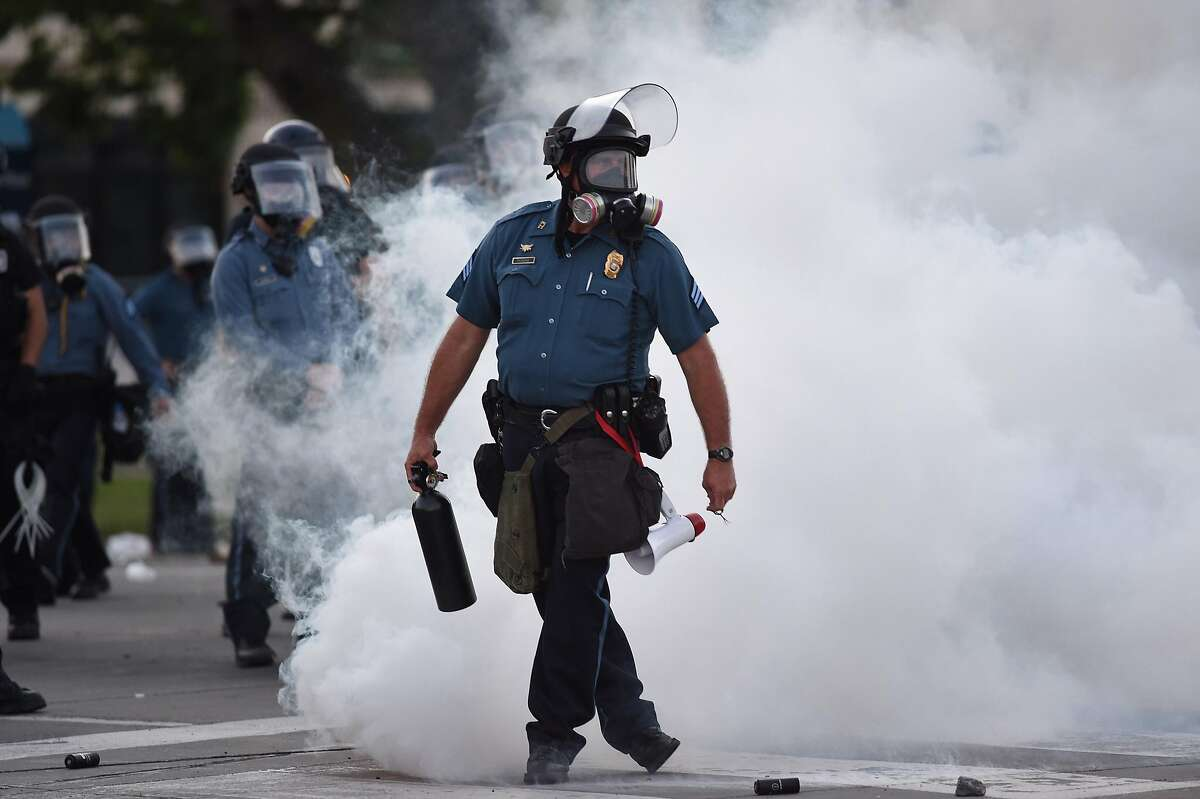 Law enforcement officers stand guard after tear gas was deployed near 47th and Main Street Sunday, May 31, 2020 during the George Floyd protest. (Tammy Ljungblad/The Kansas City Star/TNS)