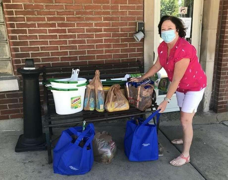 State Rep. Monica Bristow, D-Alton, drops off supplies to the Oasis Women's Shelter through a contactless donation after coordinating a drive to help provide more of the most-needed supplies for the center as they provide emergency shelter for domestic violence victims and their children.