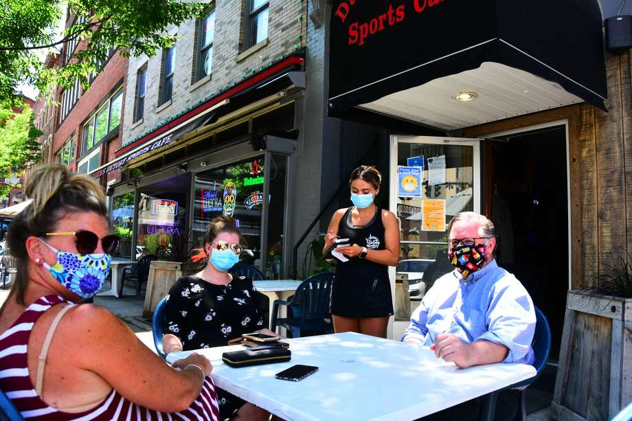 Autumn Waterhouse, standing, takes a lunch order, from left, from Lisa Mooney, Julia Watjen and Tom Connolly at Dawn's Victory Cafe in Albany on Thursday, June 4, 2020. (Photo by Steve Barnes/Times Union.) Photo: Steve Barnes/Times Union
