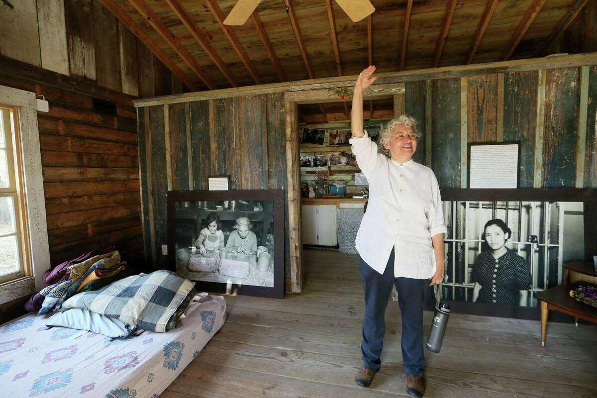 Graciela Sanchez, director of Esperanza Peace & Justice Center, talks about La Casita, a small barrio home that has been restored as faithfully as possible, at Rinconcito de Esperanza, 816 S. Colorao St., in 2017.