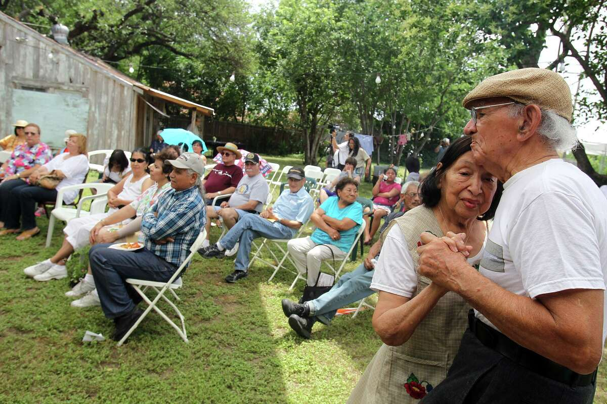 Enrique and Isabel Sanchez dance to the music of accordionist Eva Ybarra during Paseo Por El Westside, the West Side community's celebration of National Historic Preservation Month, at Rinconcito de Esperanza, in 2010.