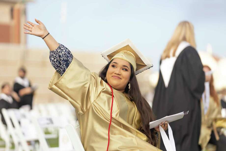 Veronica Guadalupe Hernandez waves at her family during a Conroe High School graduation ceremony at Woodforest Bank Stadium in Shenandoah, Thursday, June 4, 2020. Graduates and families were asked to practice social distancing to prevent any spread of the COVID-19 virus. Photo: Gustavo Huerta, Houston Chronicle / Staff Photographer / Houston Chronicle © 2020