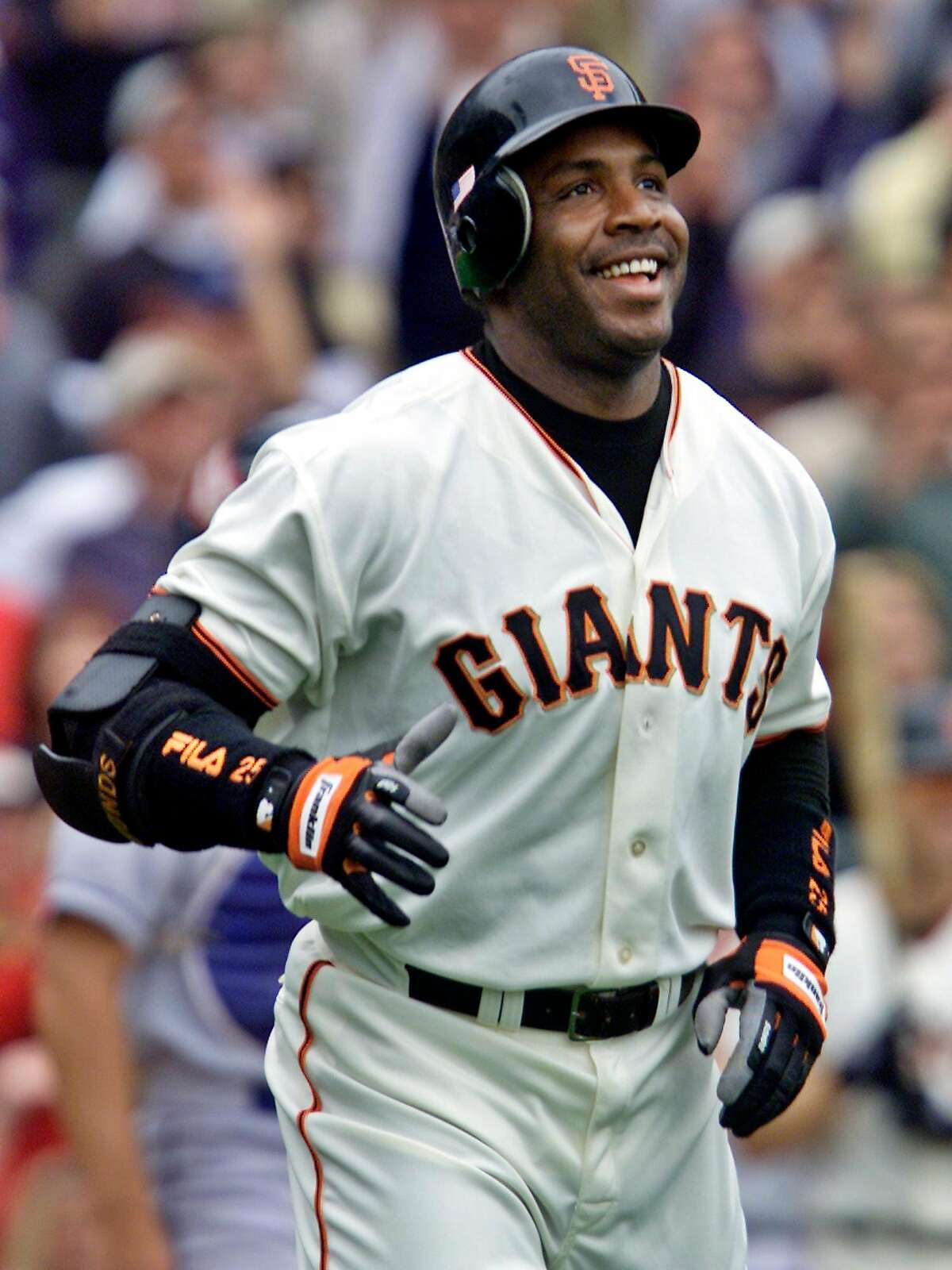 ** FILE ** In this Oct. 7, 2001, file photo, San Francisco Giants' Barry Bonds smiles as he begins to round the bases after he hit his 73rd home run of the season, against the Los Angeles Dodgers at Pacific Bell Park in San Francisco. Federal prosecutors say they will prove personal trainer Greg Anderson supplied Bonds with the steroids that led to positive test in November 2000, the offseason before the slugger hit a major league record 73 home runs. (AP Photo/Eric Risberg, File)