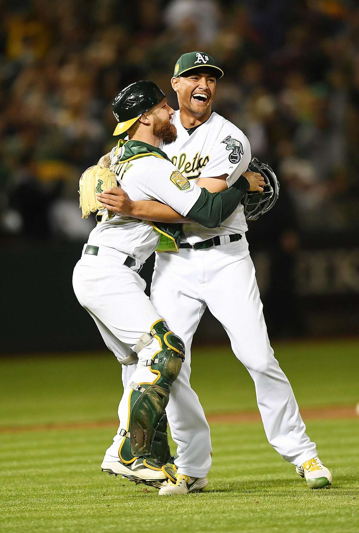 OAKLAND, CA - APRIL 21: Sean Manaea #55 and Jonathan Lucroy #21 of the Oakland Athletics celebrates after Manaea pitched a no-hitter against the Boston Red Sox at the Oakland Alameda Coliseum on April 21, 2018 in Oakland, California. The Athletics won th