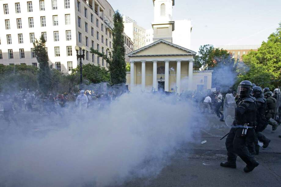 Peaceful protestors, journalists, and clergy were forcibly dispersed by police using flash grenades and chemical spray so that President Donald Trump could walk across Lafayette Square, the park in front of the White House, for a photo opportunity in front of St. John's Episcopal Church. Photo: JOSE LUIS MAGANA - Getty Images