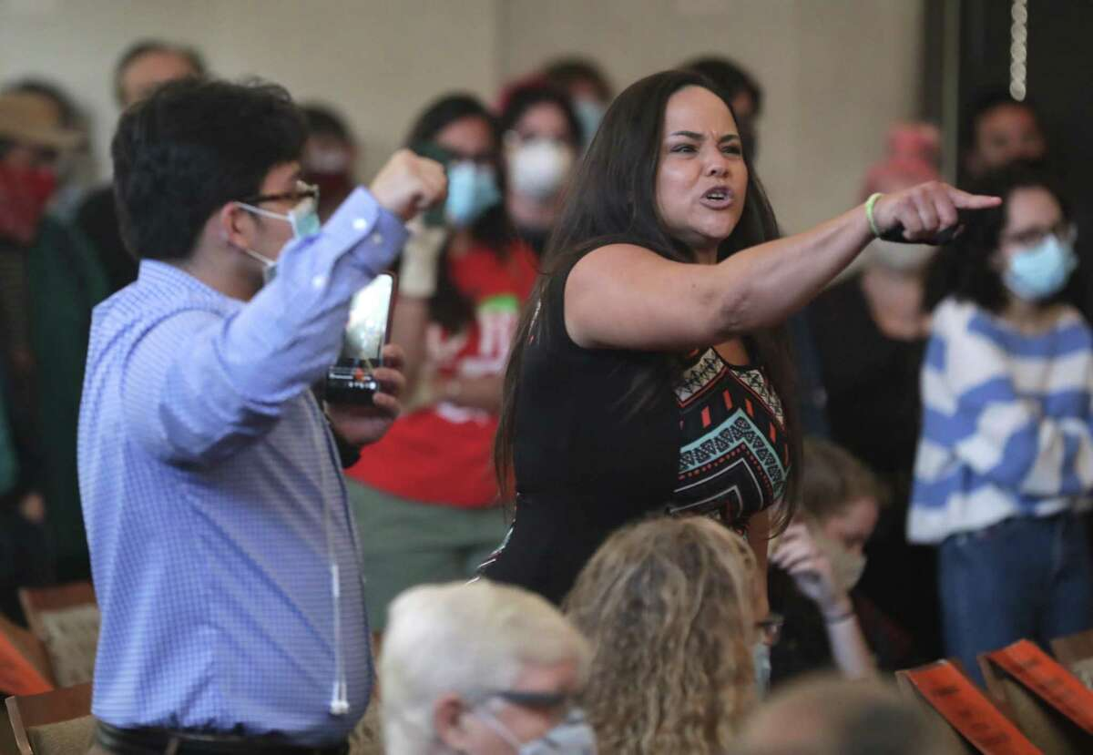 Jolene Garcia, right, yells at city council members concerning the police funding, on Thursday , June 4, 2020.