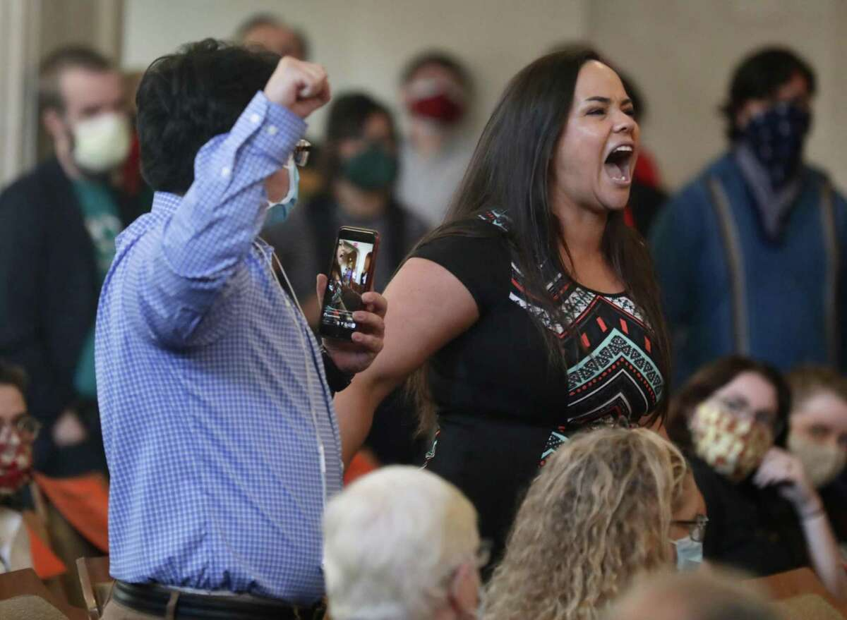An angry Jolene Garcia, right, yells at San Antonio City Council members during a council meeting Thursday, June 4, 2020. Garcia was among the demonstrators who have taken to San Antonio streets to seek justice for George Floyd, who died in the custody of a Minneapolis police officer who has been charged with murder in his death. She and others want the council to cut funding to the police department.