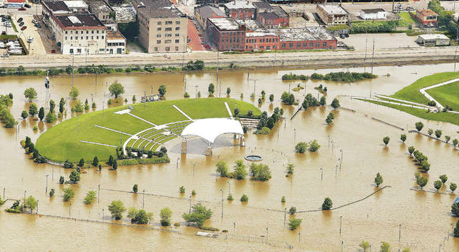 "Rising floodwaters from the Mississippi River could be seen surrounding the Liberty Bank Amphitheater in Riverfront Park one year ago on June 4, 2019. This week five environmental groups filed suit against the U.S. Corps of Engineers alleging it is wreaking havoc on the river with its ""training"" structures."