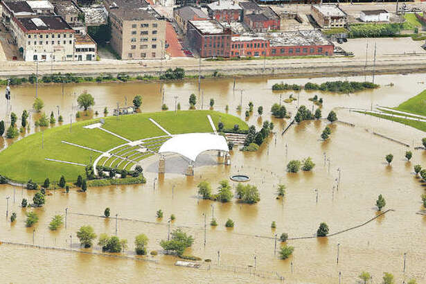 """Rising floodwaters from the Mississippi River could be seen surrounding the Liberty Bank Amphitheater in Riverfront Park one year ago on June 4, 2019. This week five environmental groups filed suit against the U.S. Corps of Engineers alleging it is wreaking havoc on the river with its """"training"""" structures."""