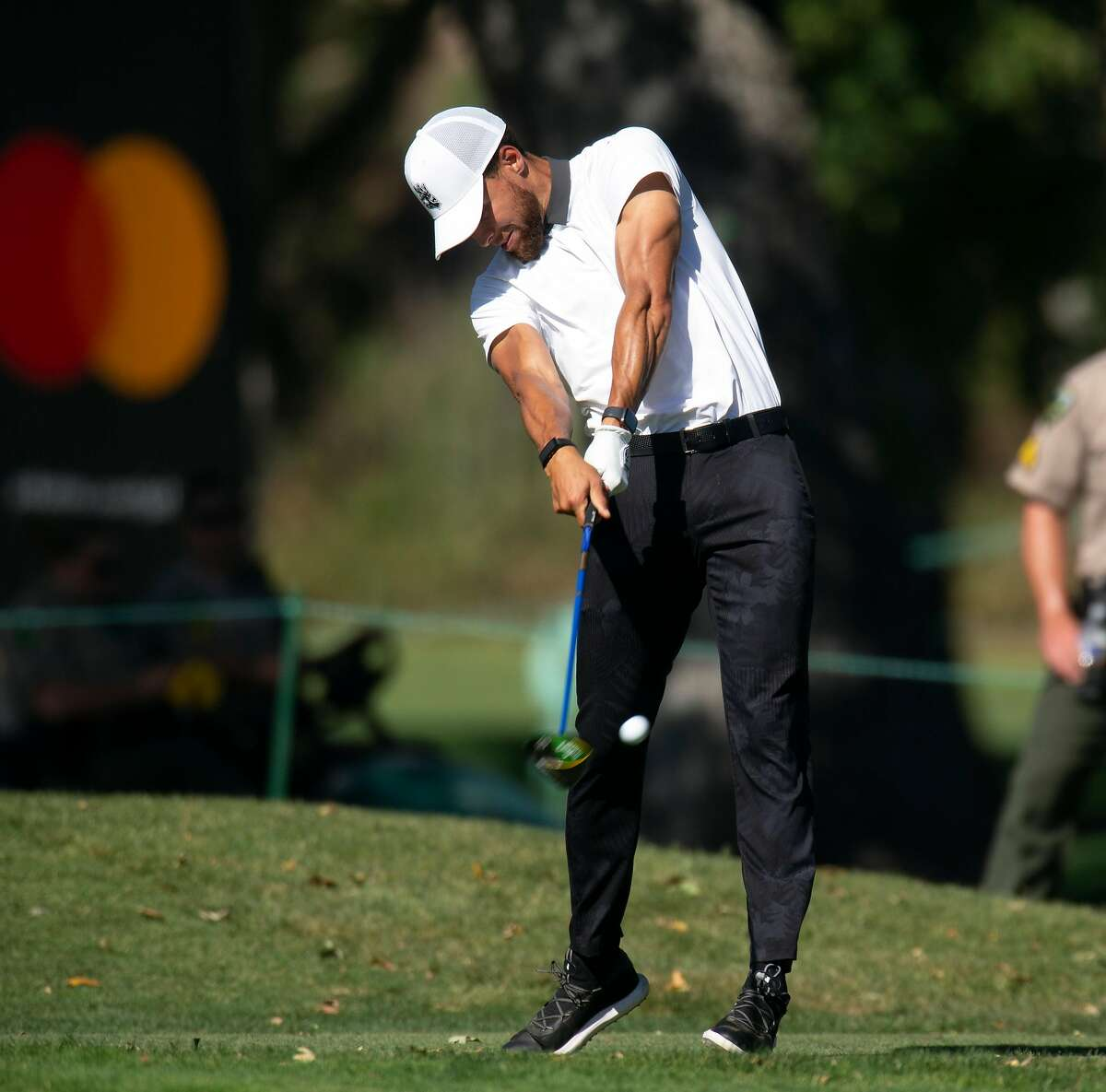 Golden State Warriors star Stephen Curry hits a driver on the 16th hole during the Safeway Open pro-am golf event on Wednesday, Sept. 25, 2019 in Napa, Calif.
