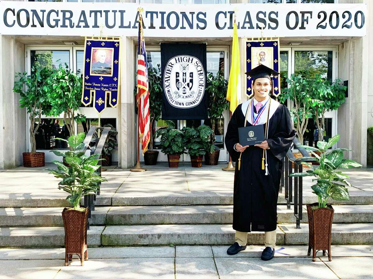 Xavier High School held its graduation ceremonies virtually May 22 to 24. Shown here is Shreyas Vasireddy, who had just received his diploma in Middletown.