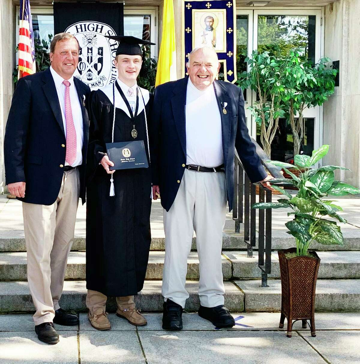 Xavier High School graduate Stephen Kohs, center, is seen with his father, Mike Kohs, and grandfather, Artie Kohs.