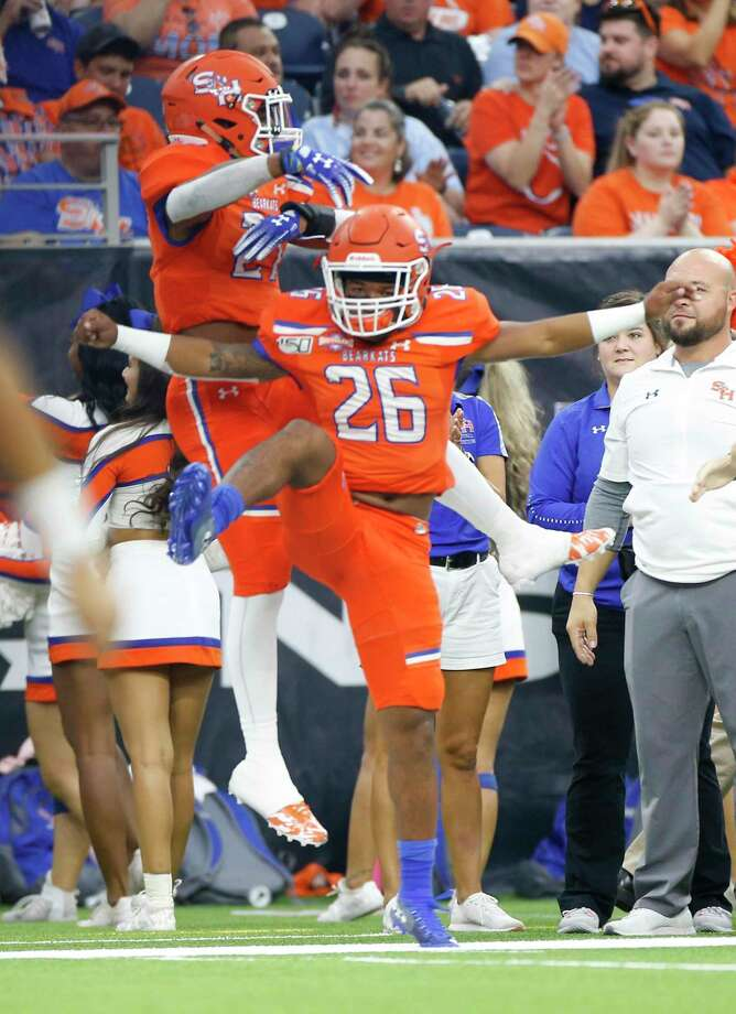 Sam Houston State Bearkats running back Kyran Jackson (26) and Sam Houston State Bearkats running back Donovan Williams (27) celebrate the team's first touchdown in the first half against Stephen F. Austin Lumberjacks at NRG Stadium on Saturday, Oct. 5, 2019. Photo: Elizabeth Conley, Houston Chronicle / Staff Photographer / © 2018 Houston Chronicle