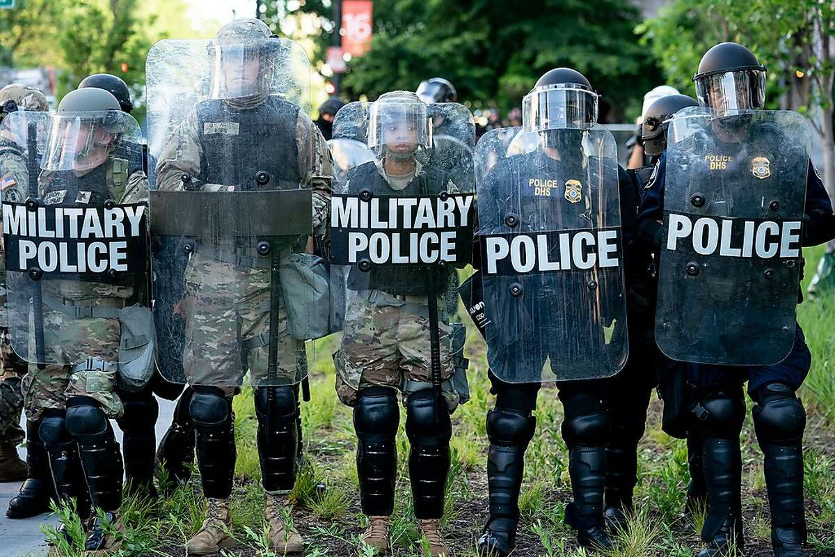 Military police and other law enforcement in Washington, near the White House, on Monday, June 1, 2020. Retired senior military leaders condemned their successors in the Trump administration for ordering active-duty units on June 1, to rout those peacefully protesting police violence near the White House. (Erin Schaff/The New York Times)