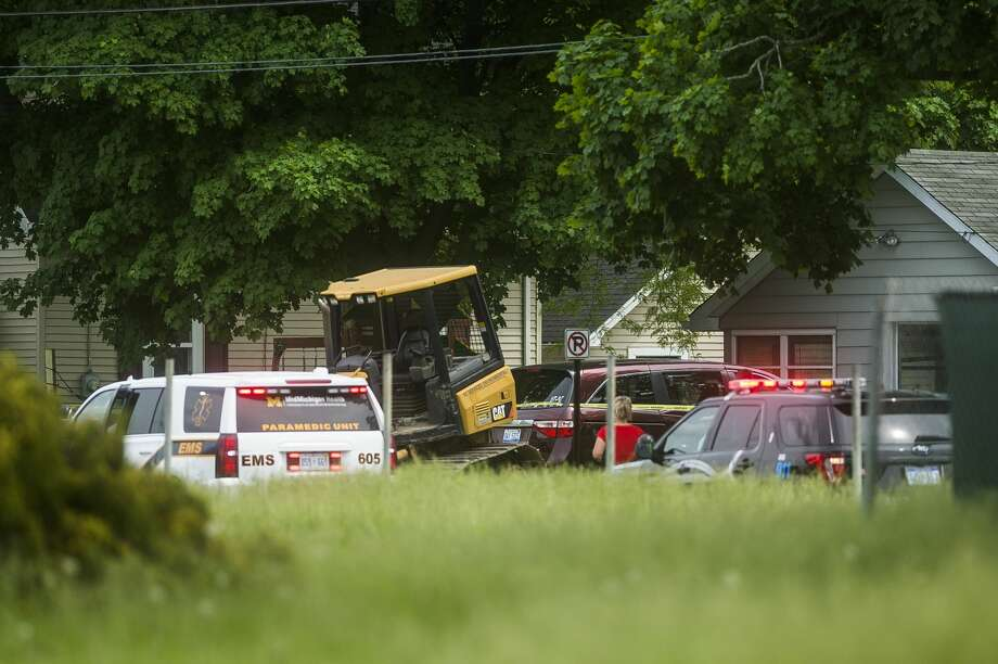 Midland Police investigate a fatal accident Thursday afternoon, June 4, 2020 at the intersection of Eastlawn Drive and Cleveland Avenue near the construction site at Eastlawn Elementary School. (Katy Kildee/kkildee@mdn.net) Photo: (Katy Kildee/kkildee@mdn.net)