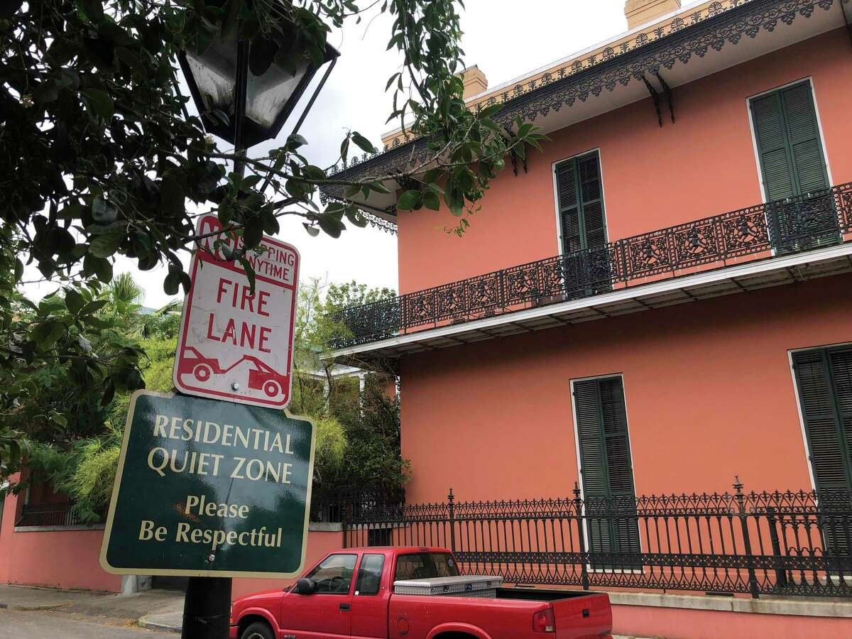 A lamp post in New Orleans' French Quarter reminds visitors that there are residences in the historic district that is best known for its restaurants and bars.