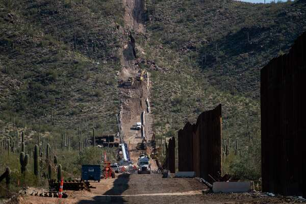 The border fence construction continues up a mountain in the Organ Pipe Cactus National Monument in Lukeville, Arizona, in January.