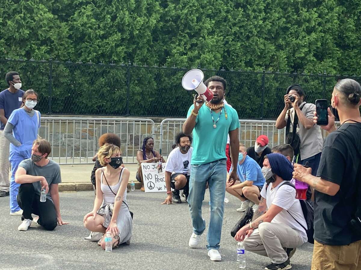 Protesters marched down Eagle Street in Albany on Thursday, June 4, 2020 to protest the police killing of George Floyd and other police killings of black people. When they got to the governor's mansion, they stopped and knelt.