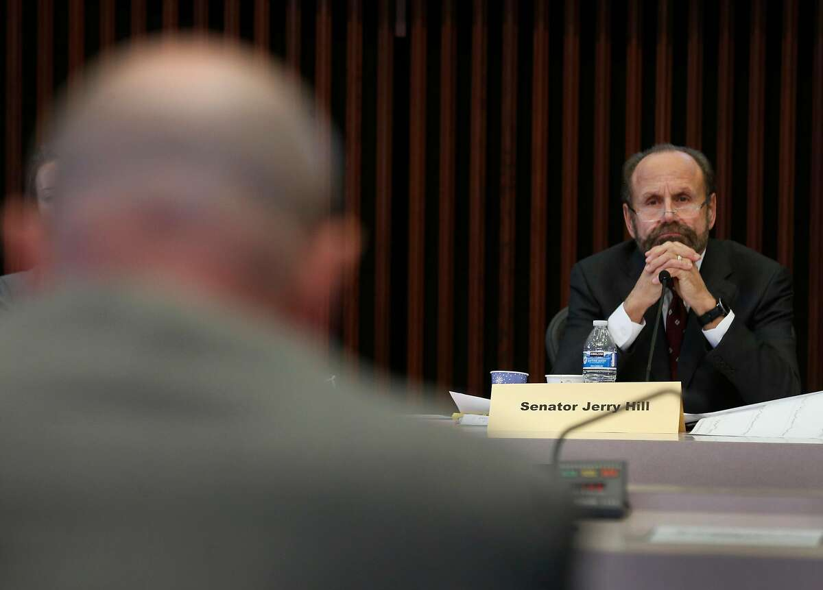 State Sen. Jerry Hill listens to testimony from Phil Herrington, a senior v.p. for Southern California Edison, a hearing of the Senate Energy, Utilities and Communications subcommittee on gas, electric and transportation safety in Santa Rosa, Calif. on Friday, Jan. 26, 2018.