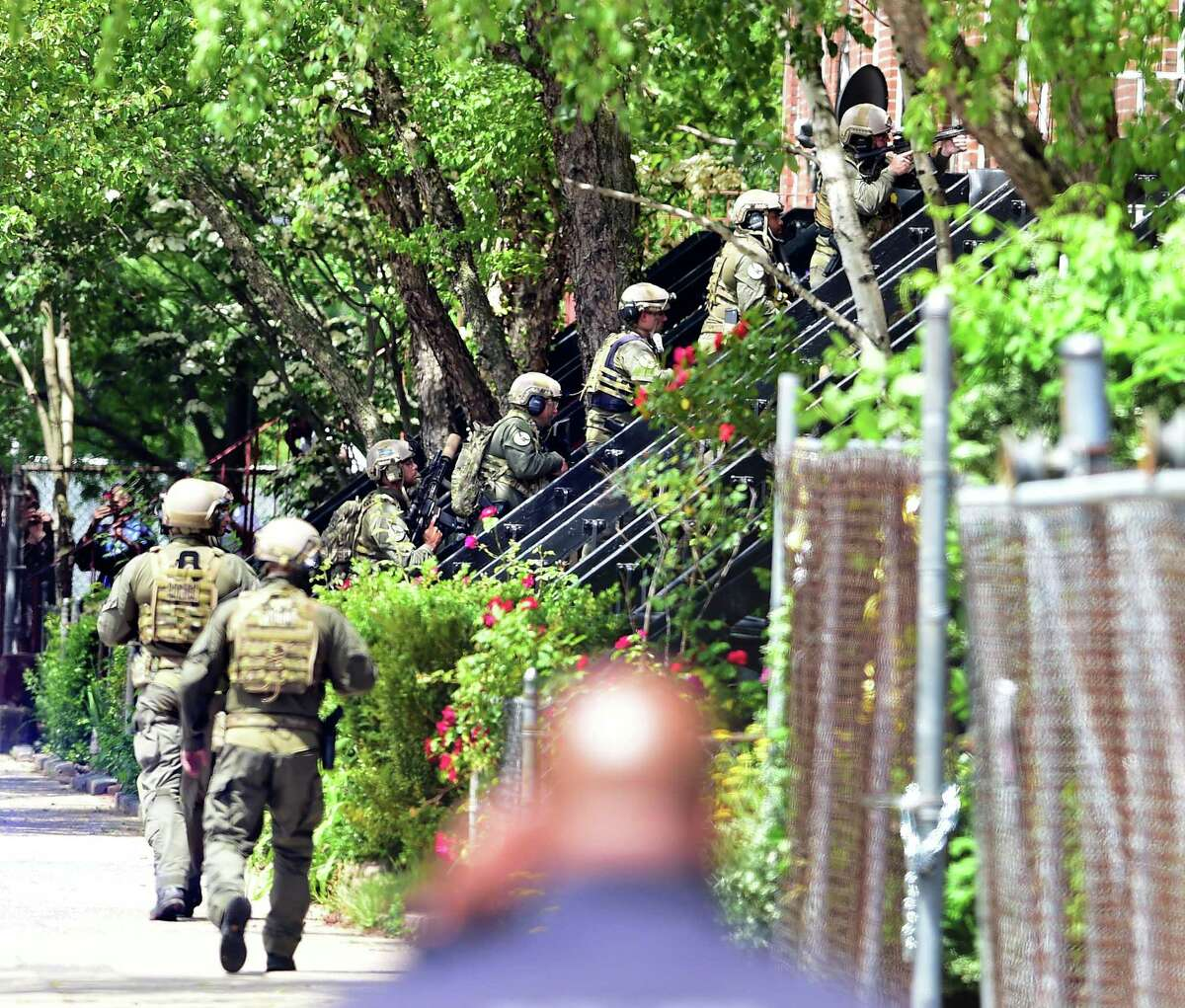 New Haven Police enter a residence on Henry Street in New Haven on June 4, 2020, in the aftermath of a hostage situation.