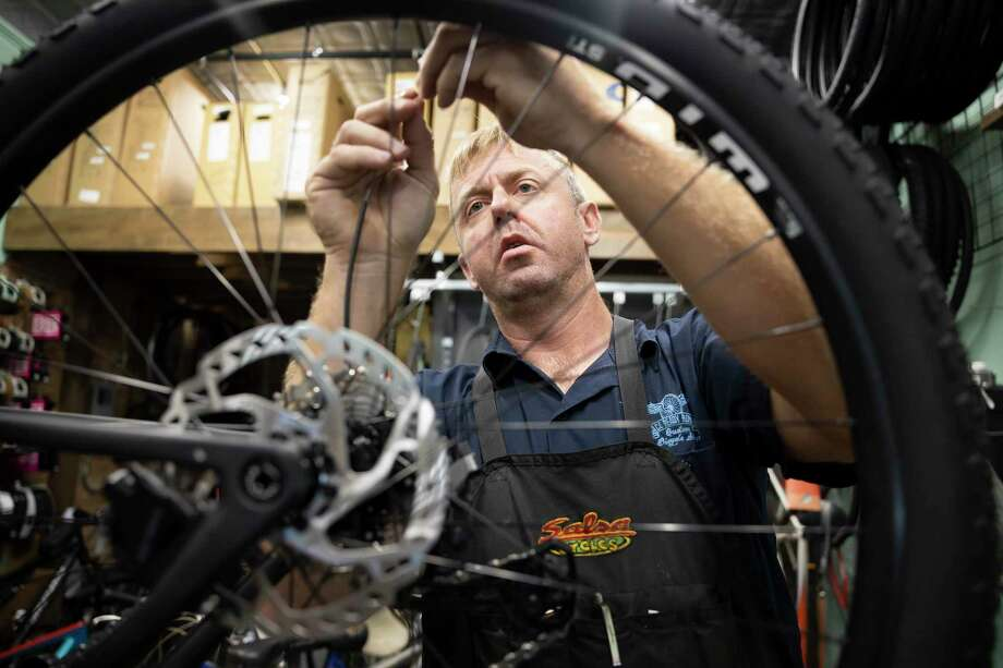 Gary Rogers repairs a bike in his bike shop at Race Ready Repairs in downtown Conroe, Thursday, June 4, 2020. Rogers has seen a boom in sales since the COVID-19 pandemic started stating that more people are looking for different outdoor recreation activities. Photo: Gustavo Huerta, Houston Chronicle / Staff Photographer / Houston Chronicle © 2020