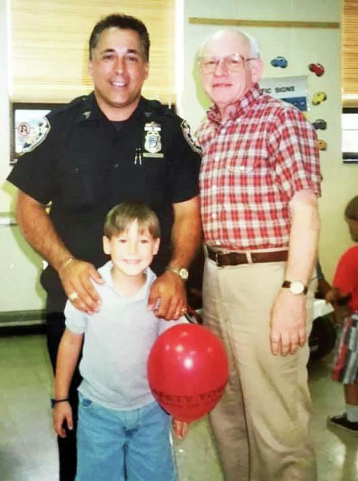 Middletown Common Council Minority Leader Phil Pessina, left, and the late Clayton Hewitt, right, a former Middletown police officer, are shown with Hewitt's grandson during the late 1970s to early 1980s during a Safety Town graduation.