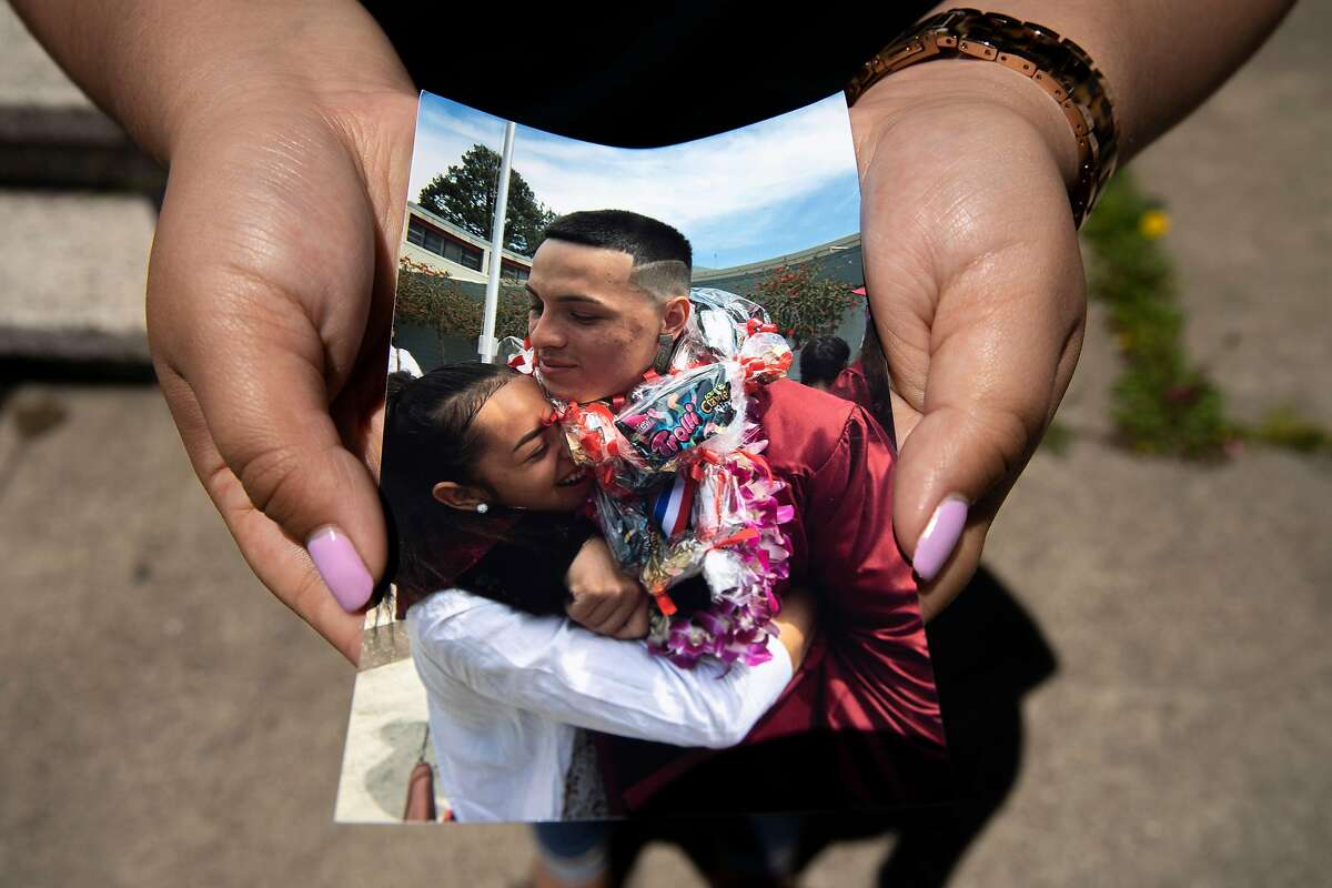 Ashley Monterrosa holds a photo of her hugging her brother Sean Monterrosa at Sean�s 2016 graduation, Thursday, June 4, 2020, in San Francisco, Calif. Her brother Sean Monterrosa, 22, was fatally shot by Vallejo police. He was kneeling outside a Walgreens and not carrying a firearm when an officer opened fire � sending five bullets through his own windshield. Monterrosa, of San Francisco died after the shooting at around 12:30 a.m. Tuesday, but police did not tell the public the man was killed � or disclose the circumstances of the shooting � until Wednesday at a news conference outside City Hall, a day after calling in 50 troops from the National Guard to help control protests and rioting sparked by the Minnesota police killing of George Floyd.