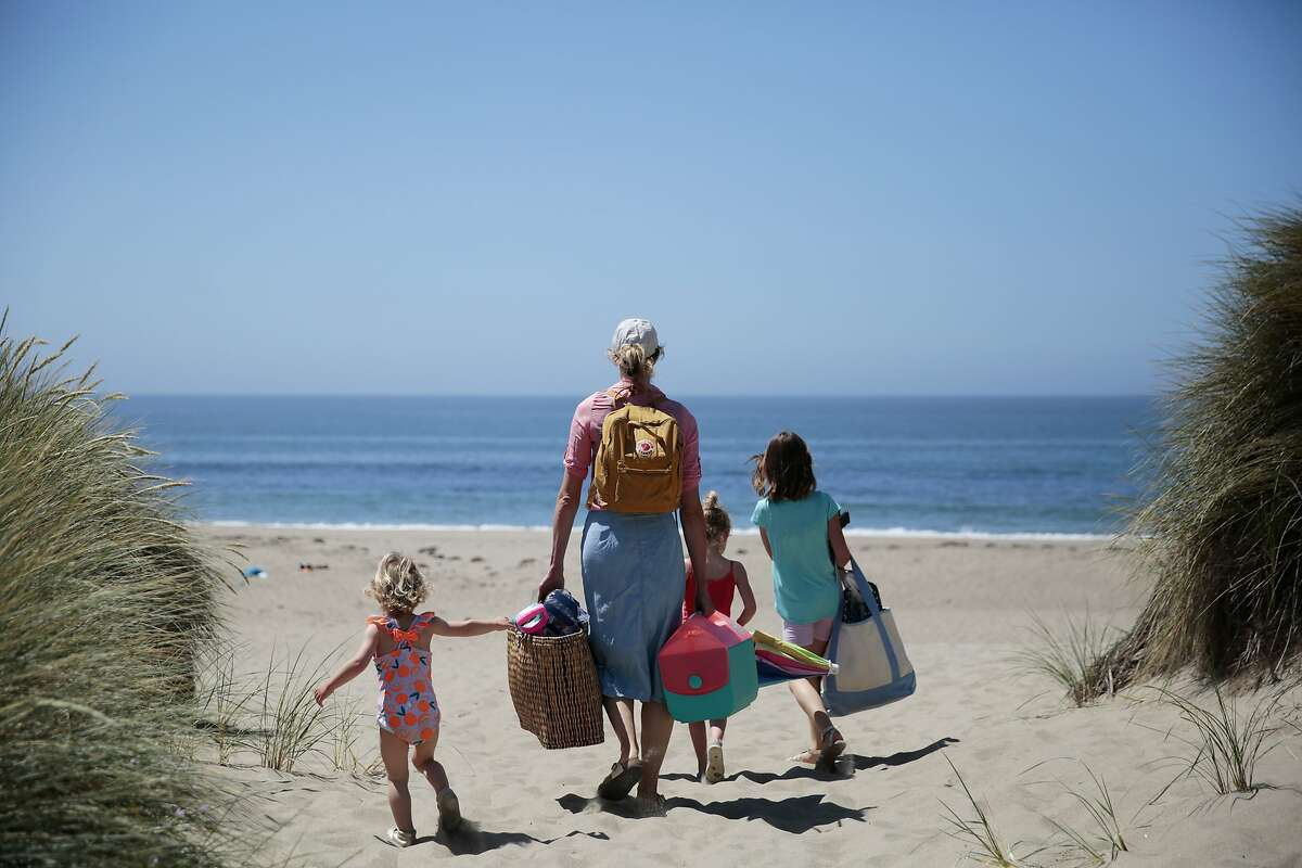 A family arrives at Limantour Beach in the Point Reyes National Seashore, California, Wednesday, June 3, 2020. National parks have reopened to visitors with some restrictions. Ramin Rahimian/Special to The Chronicle