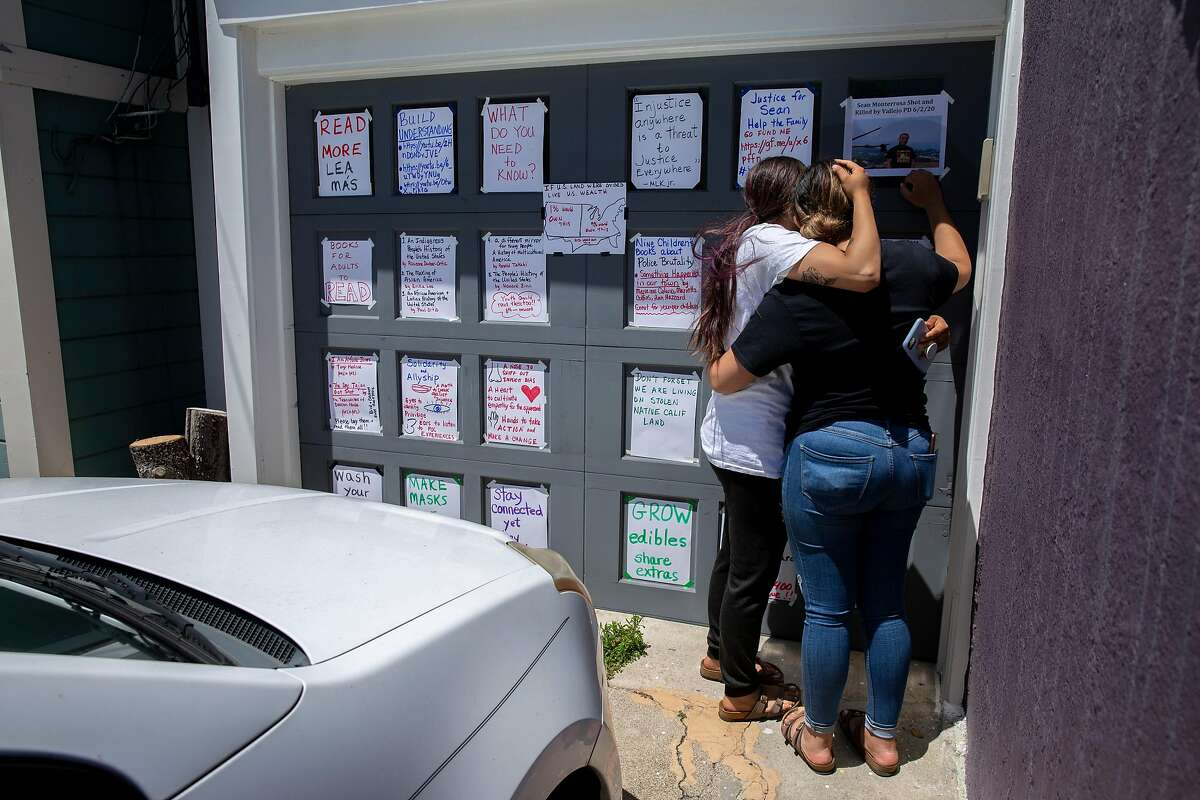 From left: Michelle Monterrosa and her sister Ashley Monterrosa comfort each other as their family friend put a photo up of their brother Sean Monterrosa on Thursday, June 4, 2020, in San Francisco, Calif. Sean Monterrosa, 22, was fatally shot by Vallejo police. Sean was kneeling outside a Walgreens and not carrying a firearm when an officer opened fire � sending five bullets through his own windshield. Monterrosa, of San Francisco died after the shooting at around 12:30 a.m. Tuesday, but police did not tell the public the man was killed � or disclose the circumstances of the shooting � until Wednesday at a news conference outside City Hall, a day after calling in 50 troops from the National Guard to help control protests and rioting sparked by the Minnesota police killing of George Floyd.