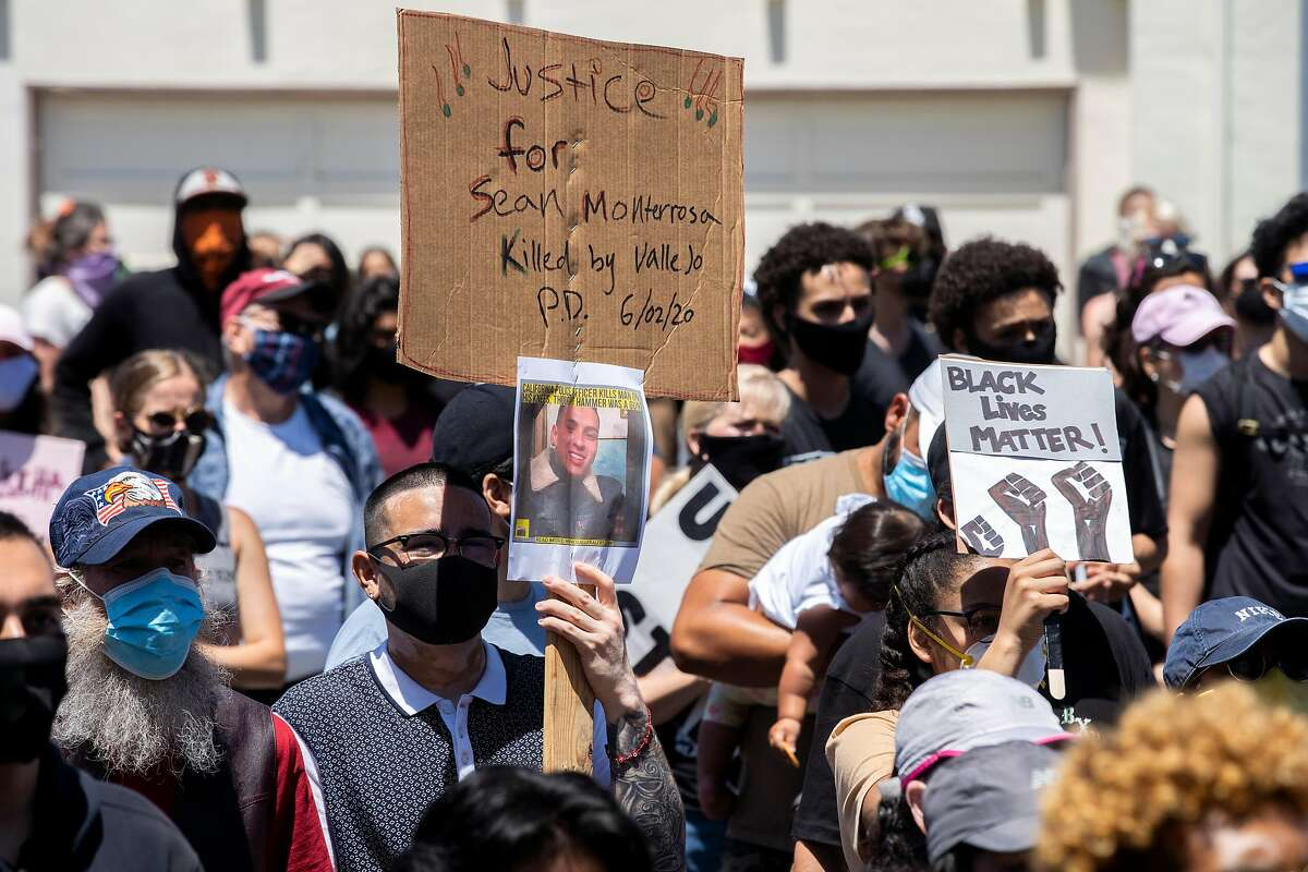 A sign calling for justice for Sean Monterrosa is seen during a George Floyd and police brutality protest on Thursday, June 4, 2020, in South San Francisco, Calif. Sean Monterrosa, 22, was fatally shot by Vallejo police. He was kneeling outside a Walgreens and not carrying a firearm when an officer opened fire � sending five bullets through his own windshield. Monterrosa, of San Francisco died after the shooting at around 12:30 a.m. Tuesday, but police did not tell the public the man was killed � or disclose the circumstances of the shooting � until Wednesday at a news conference outside City Hall, a day after calling in 50 troops from the National Guard to help control protests and rioting sparked by the Minnesota police killing of George Floyd.