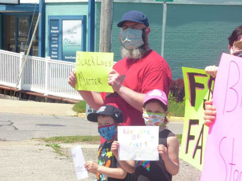 Residents of all ages turned out to demonstrations that have occurred in downtown Manistee since Sunday. (Scott Fraley/News Advocate)