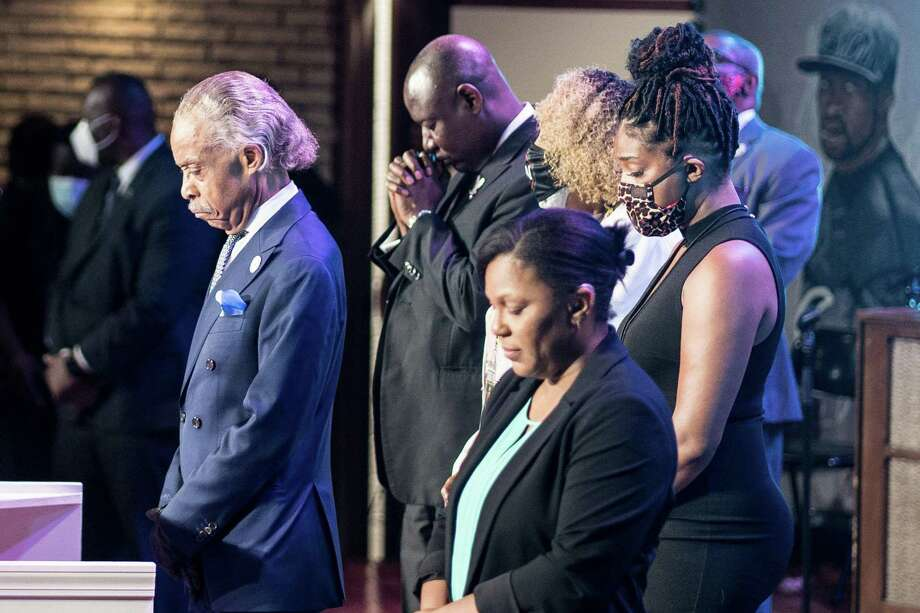 US civil rights leader Al Sharpton, left, stands with others as they bow their heads during a memorial service in honor of George Floyd on June 4, 2020, at North Central University's Frank J. Lindquist Sanctuary in Minneapolis, Minnesota. Photo: Kerem Yucel / Getty Images / AFP or licensors